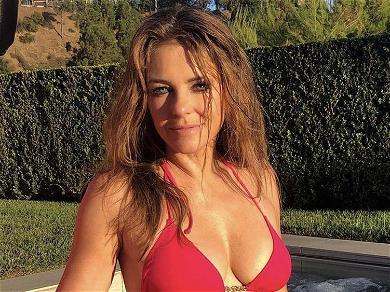 Elizabeth Hurley, 54, Wows In Hoop Bikini