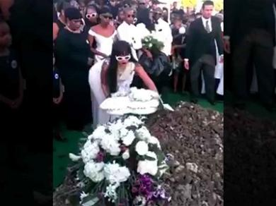 Rihanna Emotionally Lays Wreath on Casket at Cousin's Funeral