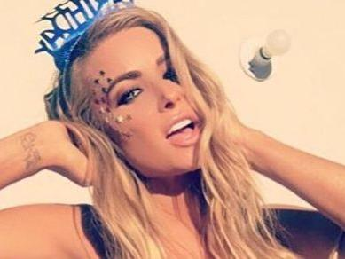 Carmen Electra Flashes Her Pom-Poms While Dominating A Piano