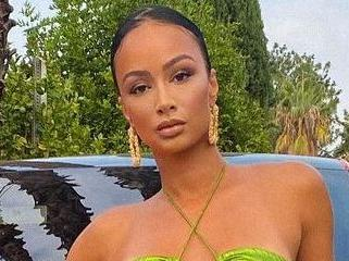 Draya Michele Lights Up Block In Thigh-Highs For Cash