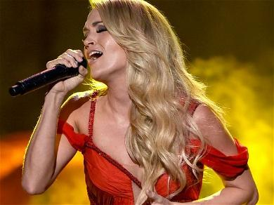 Carrie Underwood Dangles From A Rock-Climbing Wall In Leather Hot Pants Showing Mind-Blowing Body