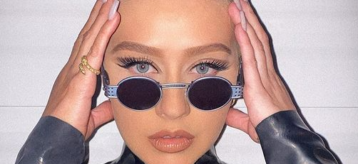 Christina Aguilera Strips Down For Midnight Swim