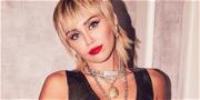 Miley Cyrus Straddles Hog In Skimpy Cheerleader Skirt