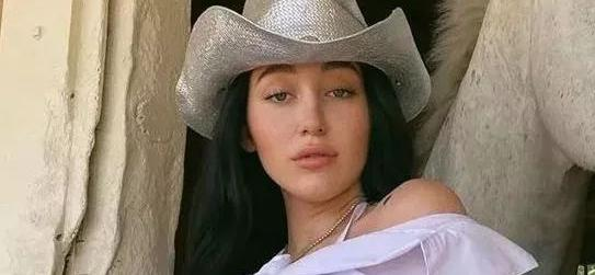 Noah Cyrus Rides Horse In Star Bikini With Pigtails