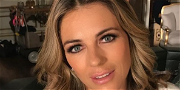 Elizabeth Hurley Is A Christmas Stunner In Plunging '90s Gucci Holiday Shirt