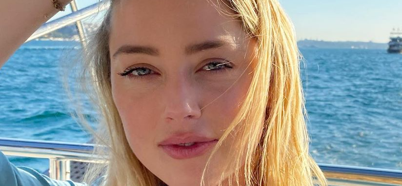 Amber Heard Stuns In Sheer Shirt After Johnny Depp's Huge Loss