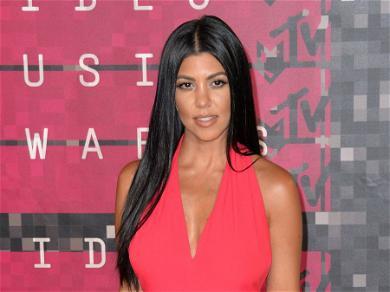 Kourtney Kardashian Says 'Leg Day' In Rockstar Boots & Spider Black Dress