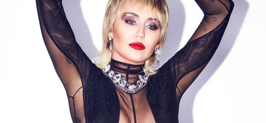 Miley Cyrus Licks Her Forbidden Fruit In Futuristic Frock