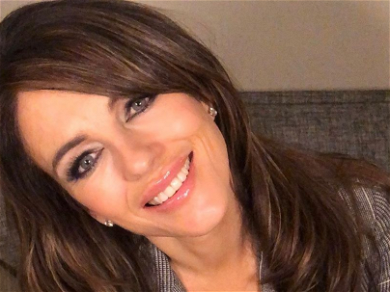 Elizabeth Hurley Skips the Gym to Relax In Revealing Dress