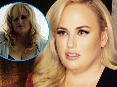 Rebel Wilson Goes Topless, Exposes Push-Up Bra & Flat Stomach After Losing Shirt