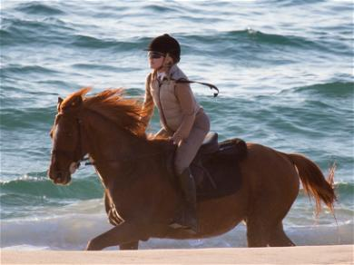 Madonna Mounts Her Mare in Portugal