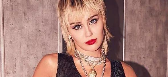 Miley Cyrus Is Santa's Naughtiest Elf, Shirtless In Open Coat