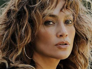 Jennifer Lopez 'Still Fly' In Plunging Bathrobe With Zero Makeup