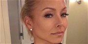 Kelly Ripa Struggles In Tight Zip Dress After Absence On 'LIVE'