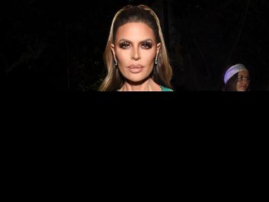 'RHOBH' Star Lisa Rinna Slips Into J Lo's Iconic Versace Dress For Halloween