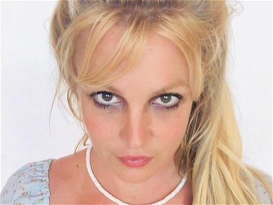 Britney Spears Tugs Down Tights In Skimpy Red Lingerie