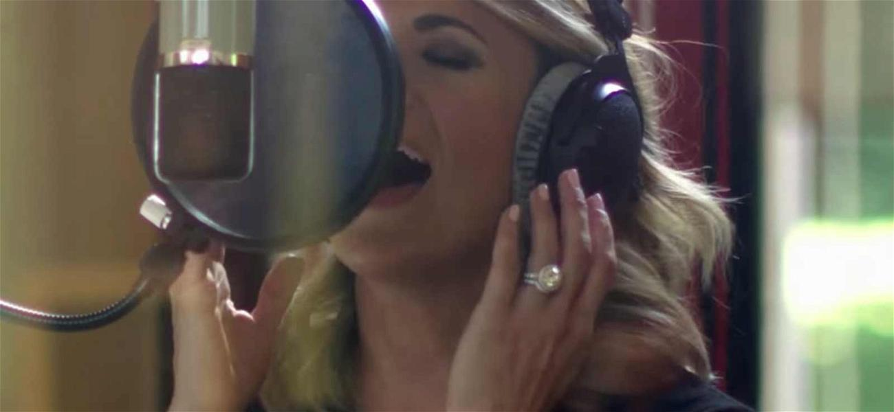 Carrie Underwood Finally Shows Her Face After Injury (Sorta) in 'The Champion' Music Video