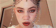 Grimes Is 'Weirdly Enjoying' Dayquil Trip After Getting COVID-19