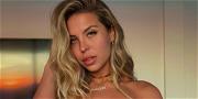 Natalia Garibotto Lies On The Beach In A Skimpy Thong Bikini