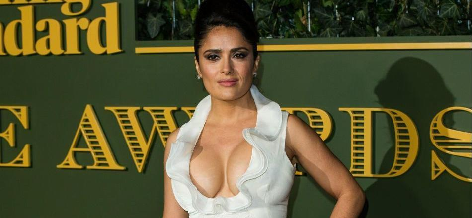 Salma Hayek All-Natural With Parted Lips Under A Woven Gucci Hat