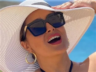 Salma Hayek Flaunts Massive Coconuts In See-Through Beach Dress