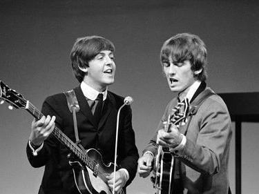 Paul McCartneySays He Still 'Talks' To Late Band Mate George Harrison