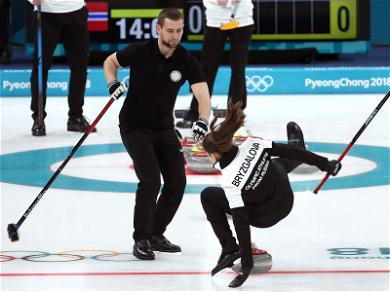 Hot Russian Curler Down!  Olympian Takes a Tumble on the Ice