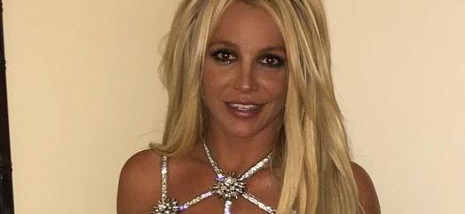 Britney Spears Bullied While Tugging Up Sheer Shirt