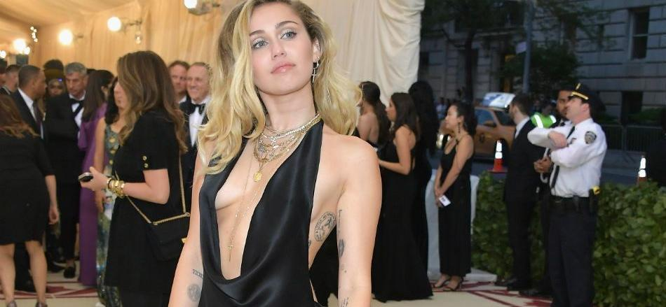 Miley Cyrus Suggestively Positions Mic In Bikini Bottoms With Chains