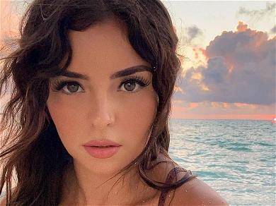 Demi Rose Swings Across Ocean In G-String Bikini