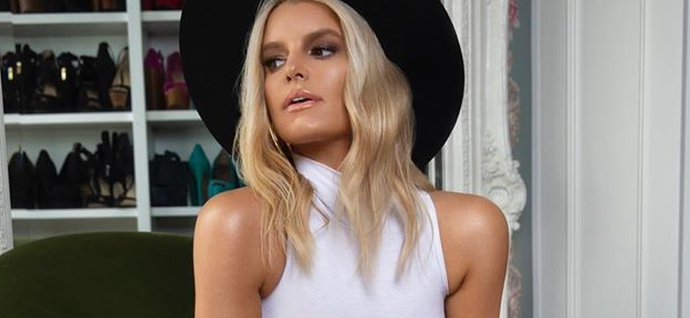 Jessica Simpson Serves Sex Appeal Lifting Dress In Cowboy Boots