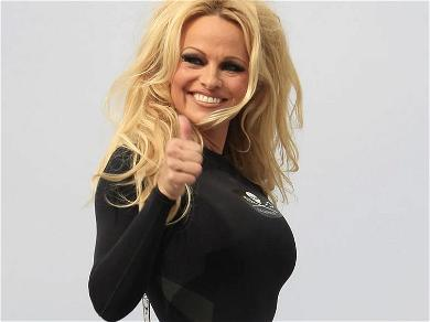 Pamela Anderson Bursts Out Naughty Santa Outfit In Fluffy Boots