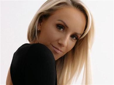 Gymnast Nastia Liukin Sandwiches Bed With Pants Rolled Up