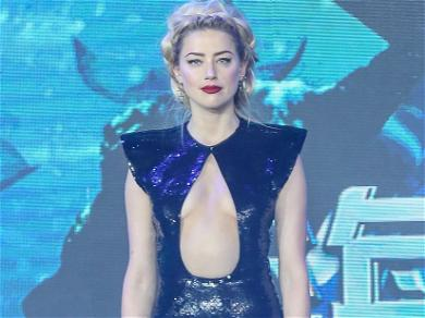 Amber Heard Goes Pin-Up On Vintage Mustang, Fiddles Comments After Fan Trashing