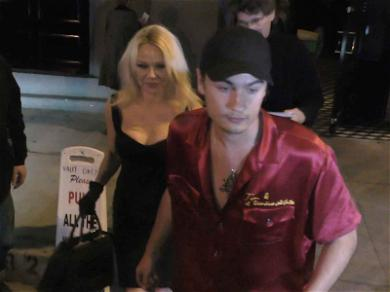 Pam Anderson Gets in Front of Cameras with Son Brandon During Battery Investigation