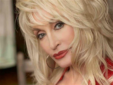 Dolly Parton Bursts Out Of Skintight Mini-Dress As 'Dolly Claus!'