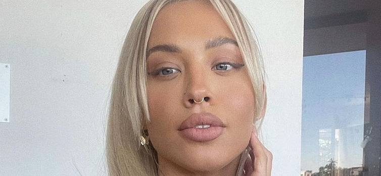Tammy Hembrow Channels 'Barbie' Vibes As She Wears Nothing Under White Robe