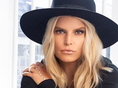 Jessica Simpson Lifts Legs In Army Boots For Surprising Flash