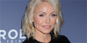 Kelly Ripa Sizzles Lifting Bare Legs On High Chair In Stilettos