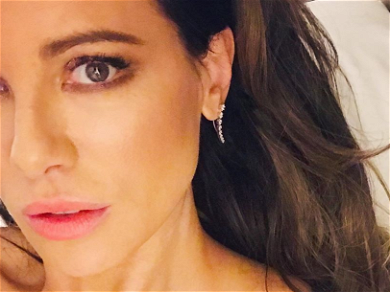 Kate Beckinsale Stuns In Revealing Dress While Guarding Janitor's Closet