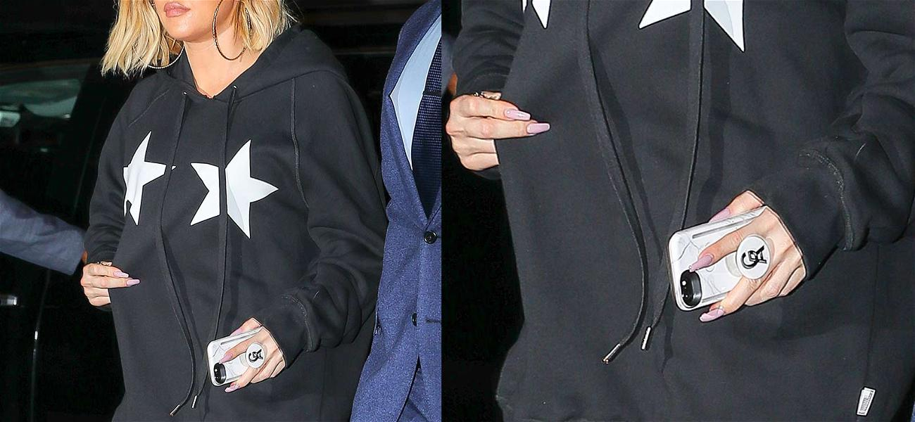 Khloé Kardashian Covers Up Baby Bump When Cameras Turn Off
