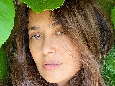 Salma Hayek Is Bursting Out Of Unbuttoned Shirt, Wind Whipping Through Her Hair!