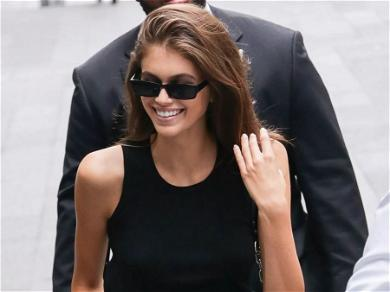 Kaia Gerber Stuns In Unbuttoned Shirt With Soaking-Wet Hair & No Pants