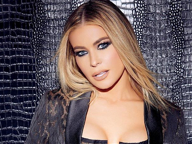 Carmen Electra Stuns In Plunging Top While Rising Like Fiery Phoenix