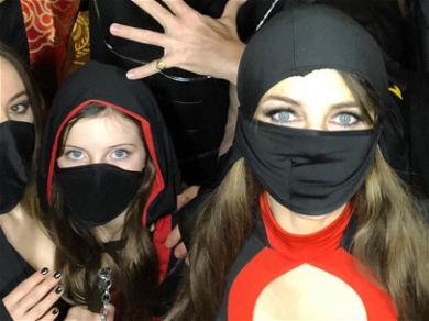 Elizabeth Hurley Is Sneaky & Sultry In Cleavage-Baring Ninja Suit