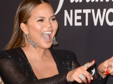 Chrissy Teigen Falls Out Swimsuit With Son Between Legs