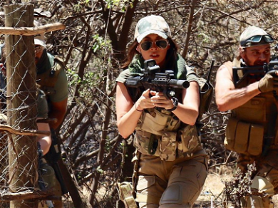 Megan Fox Shows Off Her Big Guns For Movie Training
