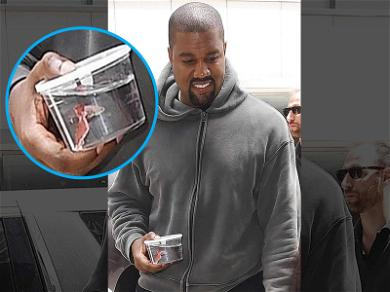 Kanye West All Smiles With New Pet Fish