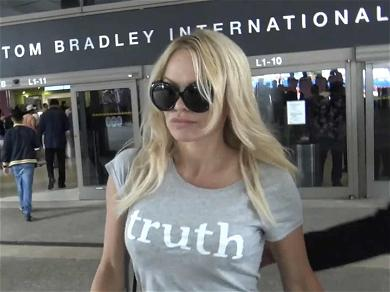 Pamela Anderson Bares 'Truth' Across Her Chest After 'Monster' Ex-Boyfriend Denies Cheating