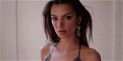 Emily Ratajkowski Stuns On Budget French Airline In Skimpy Strapless Look